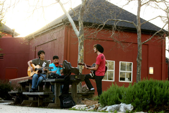Students playing music in the plaza